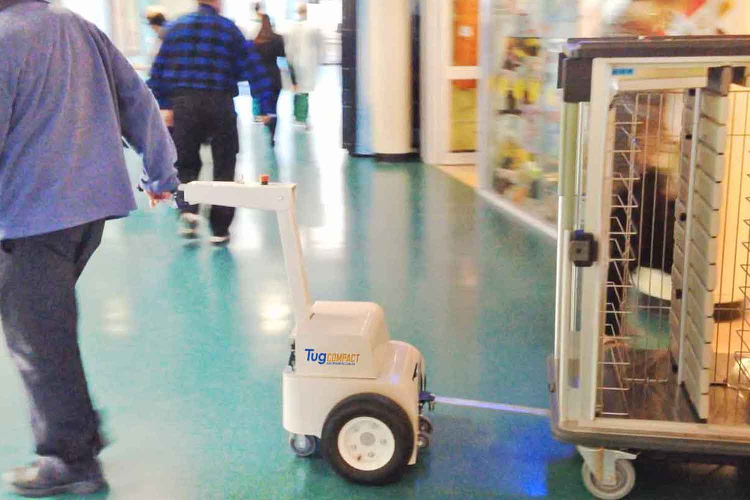 The Tug Compact towing a meal delivery trolley in a hospital